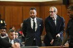 Cuba Gooding Jr., center, appears in court to face new sexual misconduct charges, Tuesday, Oct. 15, 2019, in New York. The new charges involve an alleged incident in October 2018. Gooding Jr. pleaded not guilty. The defense paints it as a shakedown attempt. (Alec Tabak/New York Daily News Pool via AP)
