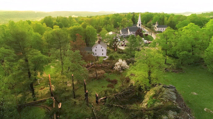 This aerial view shows storm damage to Brookfield, Conn., on Tuesday, May 15, 2018. Residents in the Northeast cleaned up Wednesday, a day after powerful storms pounded the region with torrential rain and marble-sized hail, leaving more then 200,000 homes and businesses without power.  (John Woike/Hartford Courant via AP)