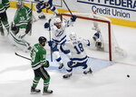 Tampa Bay Lightning center Brayden Point (21) celebrates his goal with teammate Ondrej Palat, right, as Dallas Stars goaltender Anton Khudobin (35) and center Jason Dickinson, front left, react during the second period of Game 3 of the NHL hockey Stanley Cup Final, Wednesday, Sept. 23, 2020, in Edmonton, Alberta. (Jason Franson/The Canadian Press via AP)
