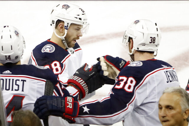 Columbus Blue Jackets center Boone Jenner (38) congratulates Columbus Blue Jackets right wing Oliver Bjorkstrand (28) after Bjorkstrand scored a goal during the third period of an NHL hockey game, Sunday, Jan. 19, 2020, in New York. Bjorkstrom scored both goals as the Blue Jackets defeated the Rangers 2-1. (AP Photo/Kathy Willens)