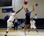 Yeshiva guard Eitan Halpert (15) jumps for a layup against Penn State-Harrisburg in an NCAA men's Division III college basketball tournament game in Baltimore, Saturday, March, 7, 2020. Yeshiva won 102-83. (AP Photo/Jessie Wardarski)
