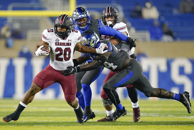 South Carolina running back Kevin Harris (20) runs with the ball during the first half of an NCAA college football game against Kentucky, Saturday, Dec. 5, 2020, in Lexington, Ky. (AP Photo/Bryan Woolston)