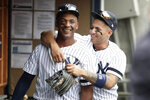 New York Yankees third baseman Miguel Andujar, left, is hugged by shortstop Gleyber Torres prior to a baseball game against the Minnesota Twins, Saturday, May 4, 2019, in New York. (AP Photo/Julio Cortez)