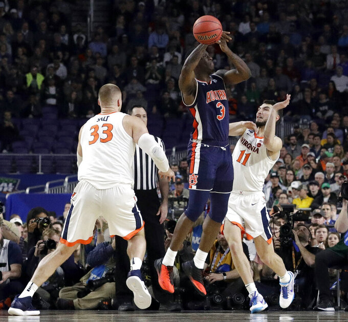 Auburn's Danjel Purifoy (3) battles for a rebound against Virginia's Jack Salt (33) and Ty Jerome (11) during the second half in the semifinals of the Final Four NCAA college basketball tournament, Saturday, April 6, 2019, in Minneapolis. (AP Photo/David J. Phillip)