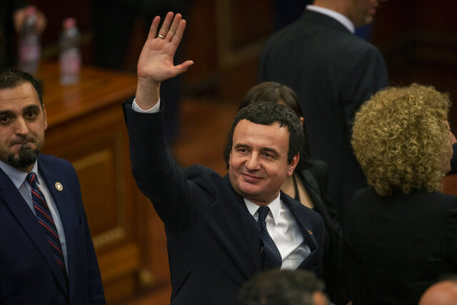 Albin Kurti, the newly elected prime minister of Kosovo waves after a new government was elected, in the capital Pristina, Monday, Feb. 3, 2020.  Kosovo's parliament convened on Monday to vote in a new prime minister after four months of talks between the country's two main parties. (AP Photo/Visar Kryeziu)