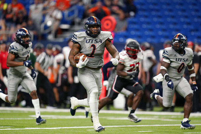 UTSA's Charles Wiley (2) returns a fumble for a touchdown against Lamar during the first half of an NCAA college football game, Saturday, Sept. 11, 2021, in San Antonio. (AP Photo/Eric Gay)