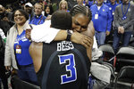 Saint Louis guard Javon Bess (3) is hugged by his mother, April Bess, after his team defeated St. Bonaventure during an NCAA college basketball final game in the Atlantic 10 men's tournament, Sunday, March 17, 2019, in New York. Saint Louis won 55-53. (AP Photo/Julio Cortez)