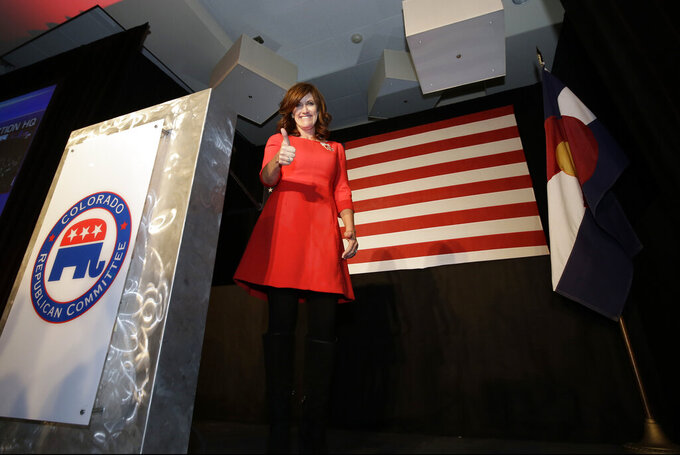FILE - In this Nov. 8, 2016 file photo Heidi Ganahl gives a thumbs up after winning CU Regent at the Colorado Republican election night party, in Greenwood Village, Colo. Ganahl, an entrepreneur and University of Colorado regent, formally launched a longshot campaign Tuesday, Sept. 13, 2021, to challenge Gov. Jared Polis' re-election bid next year, citing crime and the cost of living as two of her campaign issues. (AP Photo/Jack Dempsey, file)