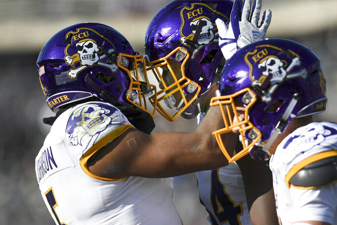 East Carolina tight end Zech Byrd (84) is congratulated by wide receiver C.J. Johnson (5) after scoring their second touchdown during the first half of an NCAA college football game against Connecticut Saturday, Nov. 23, 2019, in East Hartford, Conn. (AP Photo/Stephen Dunn)
