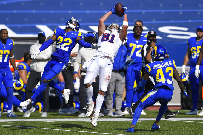 Buffalo Bills tight end Tyler Kroft (81) catches a pass in front of Los Angeles Rams' Troy Hill (22) and John Johnson (43) during the second half of an NFL football game Sunday, Sept. 27, 2020, in Orchard Park, N.Y. (AP Photo/Adrian Kraus)