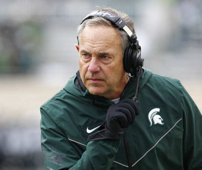 FILE - in this Oct. 27, 2018, file photo, Michigan State coach Mark Dantonio listens during the second quarter of the team's NCAA college football game against Purdue in East Lansing, Mich. Dantonio has not disclosed his starting quarterback for Saturday's game against Maryland because of the uncertain status of Brian Lewerke. (AP Photo/Al Goldis, File)