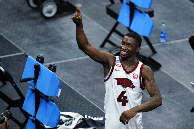 Arkansas guard Davonte Davis celebrates after a Sweet 16 game against Oral Roberts in the NCAA men's college basketball tournament at Bankers Life Fieldhouse, Saturday, March 27, 2021, in Indianapolis. Arkansas won 72-70. (AP Photo/Darron Cummings)