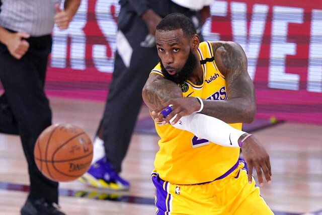 Los Angeles Lakers forward LeBron Jame makes a pass during the second half an NBA conference final playoff basketball game against the Denver Nuggets on Friday, Sept. 18, 2020, in Lake Buena Vista, Fla. (AP Photo/Mark J. Terrill)