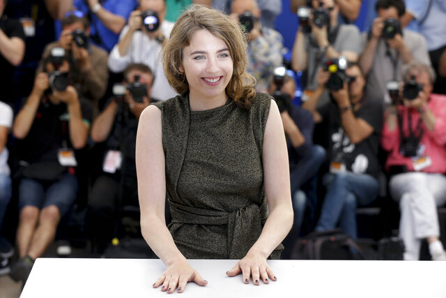 FILE - In this May 18, 2016 actress Adele Haenel poses for photographers during a photo call for the film La Fille Inconnue (The Unkown Girl) at the 69th international film festival, Cannes, southern France. The Paris prosecutor's office is investigating French director Christophe Ruggia for alleged
