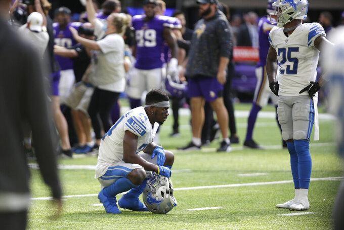 Detroit Lions cornerback Amani Oruwariye (24) and safety Will Harris (25) react at the end of an NFL football game against the Minnesota Vikings, Sunday, Oct. 10, 2021, in Minneapolis. The Vikings won 19-17. (AP Photo/Andy Clayton-King)