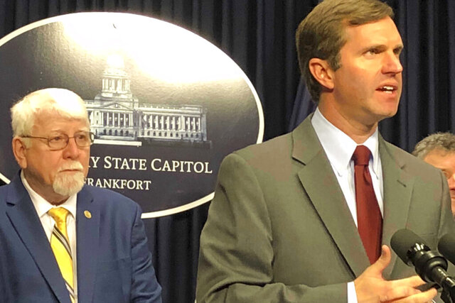 Kentucky Gov. Andy Beshear, right, promotes a bill to cap out-of-pocket costs for many Kentuckians relying on insulin on Tuesday, Feb. 18, 2020, in Frankfort, Ky. The Democratic governor was joined by a bipartisan group of lawmakers, including Republican state Rep. Danny Bentley, the bill's lead sponsor. (AP Photo/Bruce Schreiner)