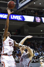 Auburn center Austin Wiley (50) shoots over Colgate forward Keegan Records (14) during the first half of an NCAA college basketball game Monday, Nov. 18, 2019, in Auburn, Ala. (AP Photo/Julie Bennett)