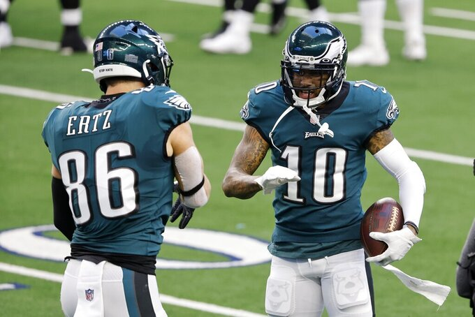 Philadelphia Eagles tight end Zach Ertz (86) and DeSean Jackson (10) celebrate a touchdown scored by Jackson on a long catch in the first half of an NFL football game against the Dallas Cowboys in Arlington, Texas, Sunday, Dec. 27. 2020. (AP Photo/Michael Ainsworth)