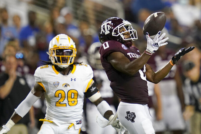 Texas A&M wide receiver Ainias Smith (0) juggles the ball before making a first down catch against Kent State safety C.J. Holmes (29) during the first half of an NCAA college football game on Saturday, Sept. 4, 2021, in College Station, Texas. (AP Photo/Sam Craft)