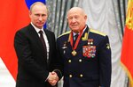 FILE - In this Friday, June 14, 2013 file photo, Russian cosmonaut Alexei Leonov, who made the first spacewalk in 1965, right, and Russian President Vladimir Putin pose for a photo in the Novo-Ogaryovo residence outside Moscow, Russia. Alexei Leonov, the first human to walk in space, died in Moscow on Friday, Oct. 11, 2019. He was 85. (Mikhail Klimentyev, Sputnik, Kremlin Pool Photo via AP, File)