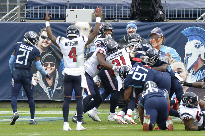 Houston Texans quarterback Deshaun Watson (4) celebrates as running back David Johnson (31) scores a touchdown against the Tennessee Titans in the second half of an NFL football game Sunday, Oct. 18, 2020, in Nashville, Tenn. (AP Photo/Mark Zaleski)