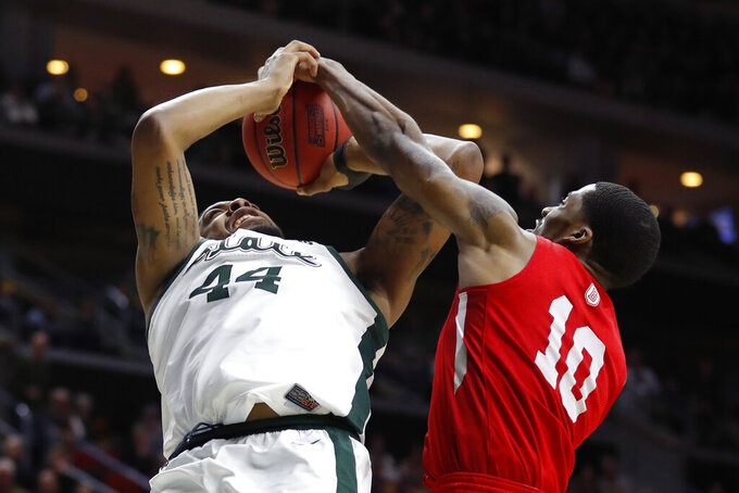 Bradley forward Elijah Childs (10) blocks a shot by Michigan State forward Nick Ward during a first round men's college basketball game in the NCAA Tournament, Thursday, March 21, 2019, in Des Moines, Iowa. (AP Photo/Charlie Neibergall)