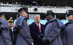 President Donald Trump, center, talks with Army Chief of Staff Gen. Mark Milley, left, watch from the stands before the Army-Navy NCAA college football game in Philadelphia, Saturday, Dec. 8, 2018. (AP Photo/Susan Walsh)