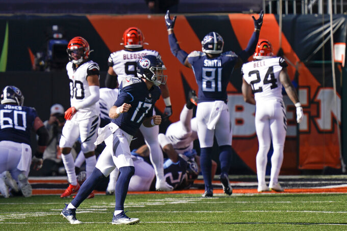 Tennessee Titans' Ryan Tannehill (17) reacts after Derrick Henry ran for a touchdown during the first half of an NFL football game against the Cincinnati Bengals, Sunday, Nov. 1, 2020, in Cincinnati. (AP Photo/Bryan Woolston)