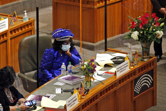 House Majority Leader Sheryl Williams Stapleton sits at her desk during the opening day of the legislative session on Tuesday, Jan. 19, 2021, in Santa Fe, New Mexico. Stapleton later introduced a bill that would outlaw hair and head covering discrimination in schools and workplaces. (AP Photo/Cedar Attanasio)