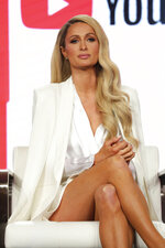 "FILE - Paris Hilton speaks at the YouTube TCA 2020 Winter Press Tour in Pasadena, Calif. on Jan. 18, 2020. Hilton says she ""finally feels free"" after discussing her time at a Utah boarding school as a teenager. She opens up about her experience in a new documentary ""This is Paris,"" debuting for free on Sept. 14 on Hilton's YouTube channel. (Photo by Willy Sanjuan/Invision/AP, File)"