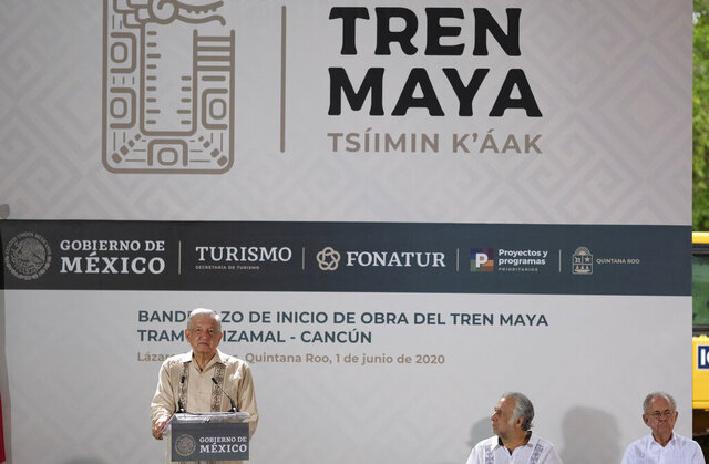 Mexican President Andres Manuel Lopez Obrador, left, speak during a ceremony in Lazaro Cardenas, Quintana Roo state, Mexico, Monday, June 1, 2020. Amid a pandemic and the remnants of a tropical storm, President Lopez Obrador kicked off Mexico's return to a