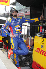Alexander Rossi listen to the teams' radio during a break practice for the Indianapolis 500 IndyCar auto race at Indianapolis Motor Speedway, Thursday, May 16, 2019 in Indianapolis. (AP Photo/Michael Conroy)