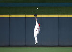 A double by Philadelphia Phillies' Jean Segura gets over the head of Cincinnati Reds center fielder Nick Senzel during the fourth inning of a baseball game Tuesday, Sept. 3, 2019, in Cincinnati. (AP Photo/Gary Landers)