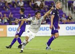 CF Montreal's Mathieu Choiniere shouts in celebration between Orlando City's Emmanuel Mas (3) and Robin Jansson (right) after Choiniere scored a goal during an MLS soccer match in Orlando, Fla., Wednesday, Sept. 15, 2021. (Stephen M. Dowell/Orlando Sentinel via AP)