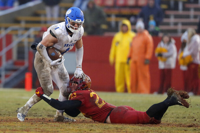 Drake wide receiver Devin Cates (1) is tackled by Iowa State linebacker Mike Rose after making a reception during the second half of an NCAA college football game, Saturday, Dec. 1, 2018, in Ames, Iowa. Iowa State won 27-24. (AP Photo/Charlie Neibergall)
