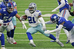 Dallas Cowboys' Ezekiel Elliott runs the ball during the first half of an NFL football game against the New York Giants, Sunday, Jan. 3, 2021, in East Rutherford, N.J. (AP Photo/Frank Franklin II)