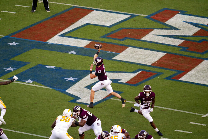 Texas A&M quarterback Haynes King (13) passes the ball against Kent State during the first quarter of an NCAA college football game on Saturday, Sept. 4, 2021, in College Station, Texas. (AP Photo/Sam Craft)