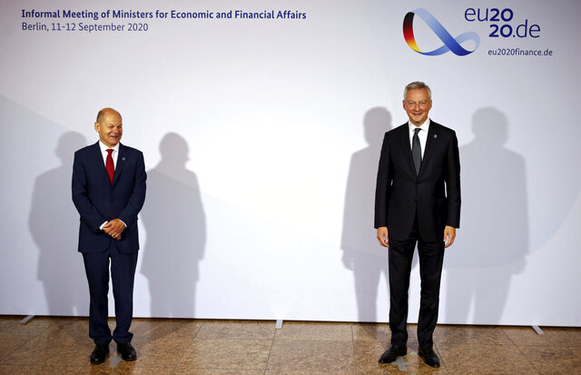 French Finance and Economy Minister Bruno Le Maire, right, is welcomed by Federal Finance Minister Olaf Scholz, left, for the Informal Meeting of Economics and Finance Ministers in Berlin, Germany, Friday, Sept. 11, 2020. (Hannibal Hanschke/Pool Photo via AP)