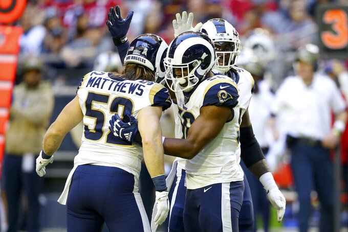 Los Angeles Rams defensive end Dante Fowler, center, celebrates his sack against the Arizona Cardinals with Los Angeles Rams outside linebacker Clay Matthews (52) during the first half of an NFL football game, Sunday, Dec. 1, 2019, in Glendale, Ariz. (AP Photo/Ross D. Franklin)