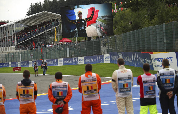 A large screen television shows Formula 2 driver Anthoine Hubert prior to the start of the Belgian Formula One Grand Prix in Spa-Francorchamps, Belgium, Sunday, Sept. 1, 2019. The 22-year-old Hubert died Saturday following an estimated 160 mph (257 kph) collision on Lap 2 at the high-speed Spa-Francorchamps track, which earlier Saturday saw qualifying for Sunday's Formula One race. (AP Photo/Francisco Seco)