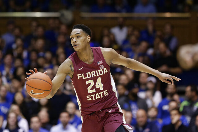 FILE - In this Feb. 10, 2020, file photo, Florida State guard Devin Vassell (24) dribbles against Duke during the first half of an NCAA college basketball game in Durham, N.C. Vassell was selected by the San Antonio Spurs in the NBA draft Wednesday, Nov. 18, 2020. (AP Photo/Gerry Broome, File)