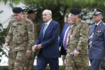 Lebanese Parliament Speaker Nabih Berri, center, arrives to attend a military parade to mark the 76th anniversary of Lebanon's independence from France at the Lebanese Defense Ministry, in Yarzeh near Beirut, Lebanon, Friday, Nov. 22, 2019. Lebanon's top politicians appeared for the first time since the government resigned amid nationwide protests now in their second month. (AP Photo/Hassan Ammar)