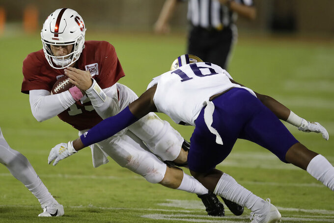 Stanford quarterback Davis Mills, left, is tackled by Washington's Cameron Williams (16) during the first half of an NCAA college football game Saturday, Oct. 5, 2019, in Stanford, Calif. (AP Photo/Ben Margot)