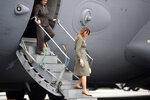 First lady Melania Trump and Karen Pence emerge from a C17 after learning about disaster preparation and response, Wednesday, Oct 30, 2019, at Joint Base Charleston, S.C. (AP Photo/Meg Kinnard)