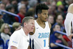 Gonzaga head coach Mark Few, left, speaks with guard Admon Gilder (1) during the second half of an NCAA college basketball game against Eastern Washington in Spokane, Wash., Saturday, Dec. 21, 2019. Gonzaga won 112-77. (AP Photo/Young Kwak)