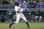 Seattle Mariners' Kyle Lewis singles in a run against the Oakland Athletics in the fifth inning of a baseball game Sunday, Sept. 29, 2019, in Seattle. (AP Photo/Elaine Thompson)