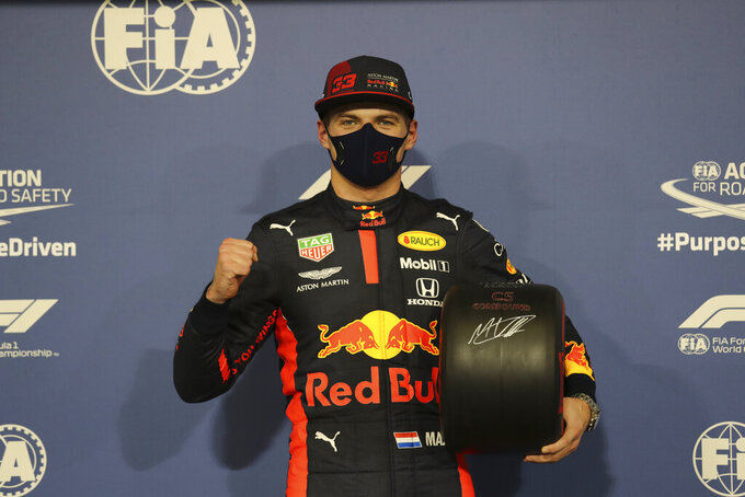 Red Bull driver Max Verstappen of the Netherlands celebrates after he won the pole position at the Formula One Abu Dhabi Grand Prix in Abu Dhabi, United Arab Emirates, Saturday, Dec. 11, 2020. (AP Photo/Kamran Jebreili, Pool)