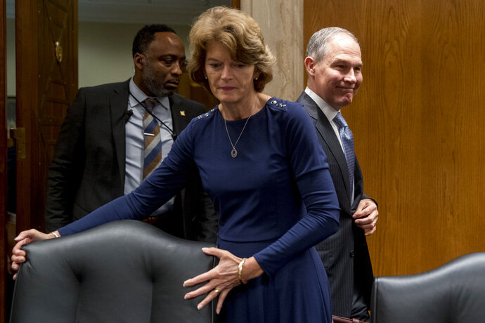 Environmental Protection Agency Administrator Scott Pruitt, accompanied by Chairman Lisa Murkowski, R-Alaska, center, and a member of his security, left, arrives to testify before a Senate Appropriations subcommittee on budget on Capitol Hill in Washington, Wednesday, May 16, 2018. Pruitt goes before a Senate panel Wednesday as he faces a growing number of federal ethics investigations over his lavish spending on travel and security. (AP Photo/Andrew Harnik)