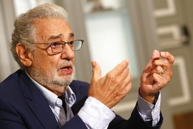 Spanish tenor Placido Domingo gestures as he answer a question during an interview with the Associated Press in Naples, Sunday, Aug. 23, 2020. Opera legend Placido Domingo denied ever abusing his power during his management tenure at two U.S. opera houses, as he  embarks on a full-throttle campaign to clear his name after two investigations found credible accusations he had engaged with ''inappropriate conduct'' with multiple women over a period of decades. (AP Photo/Riccardo De Luca)