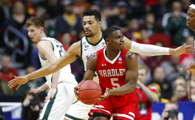 Bradley guard Darrell Brown (5) looks to pass in front of Michigan State forward Kenny Goins during a first round men's college basketball game in the NCAA Tournament, Thursday, March 21, 2019, in Des Moines, Iowa. (AP Photo/Charlie Neibergall)